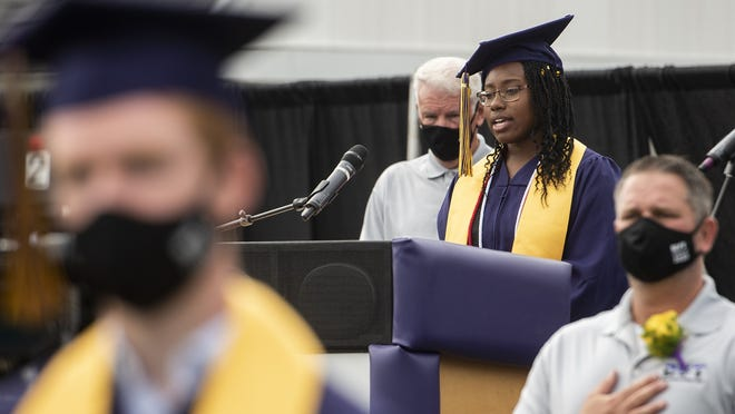 Mica McLaurin sings the national anthem before Blackstone Valley Regional Vocational Technical High School held a socially-distanced in-person graduation ceremony for the class of 2020 on Saturday.