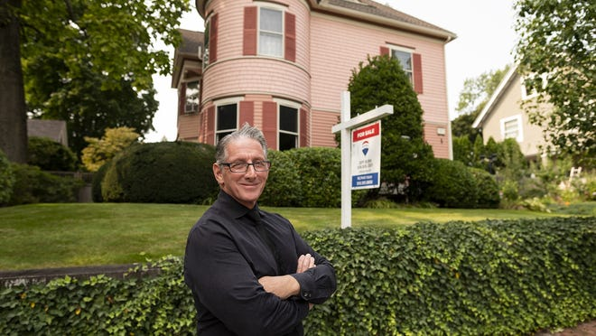 Real estate agent Jeff Burk in front of 1 Germain St. in Worcester Tuesday.