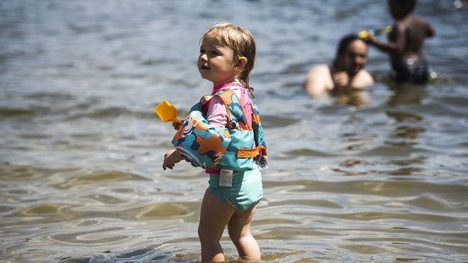 Aviva Mangiameli, 2, enjoys the cool water on a hot day at Shore Park in Worcester Saturday.