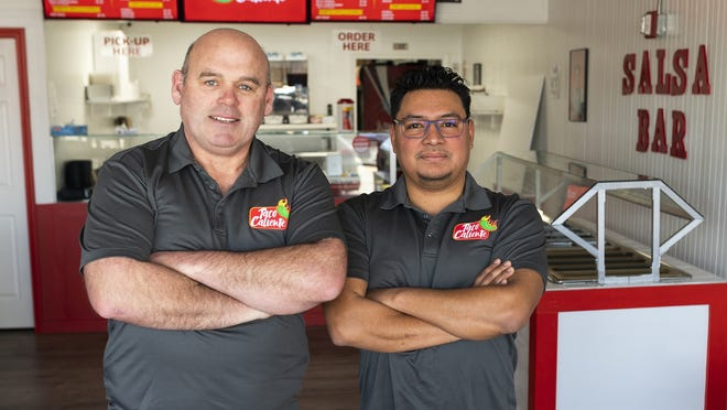 PJ Heffernan and Job Cardenas, co-owners of Taco Caliente, before the pandemic forced the restaurant to close. Taco caliente has reopened recently.