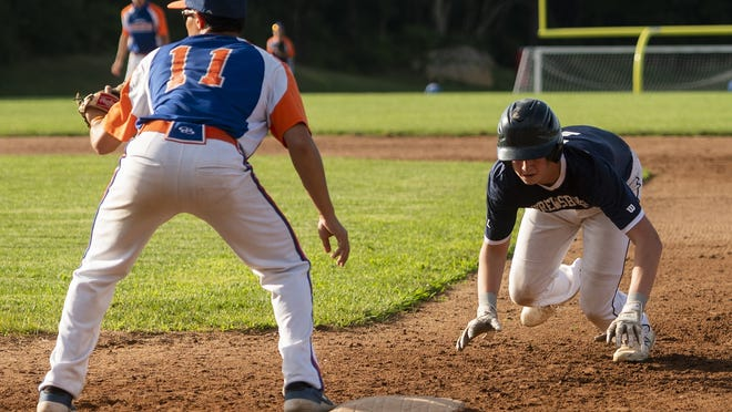 Shrewsbury's Connor Lions dives back to the bag around the throw to Leominster first baseman Dylan Sousa.