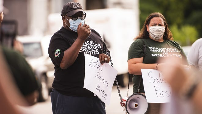 WORCESTER - Joseph Fails, an educator from North High, speaks during the Educational Association of Worcester  demonstration on Friday.