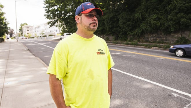 Robbie Johnson gets visibly emotional while talking about the motorcycle crash that killed a 19-year-old man on Thursday night on Lincoln Street. Johnson's daughter was turning into the driveway of their home when the motorcycle collided with her sedan, throwing him from the bike and into the rear tires of a tractor-trailer parked nearby.