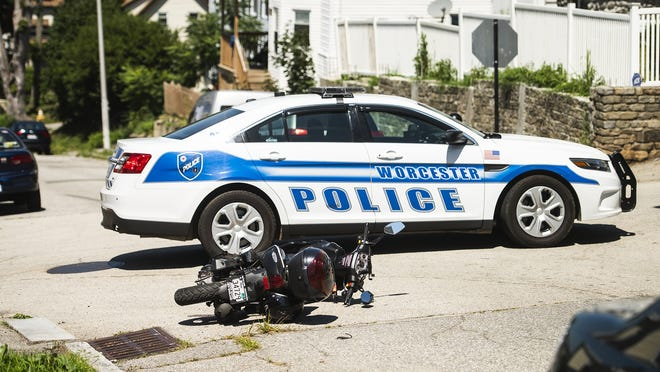 A motorcycle rests at Westminster and Orne streets in Worcester after a crash Saturday.