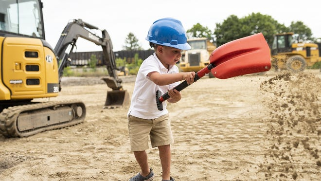 Robert Curzan, 3, gets ready to lend a hand as Table Talk Pies held a groundbreaking ceremony for its new location on Gardner Street on Thursday. View a photo gallery at telegram.com.