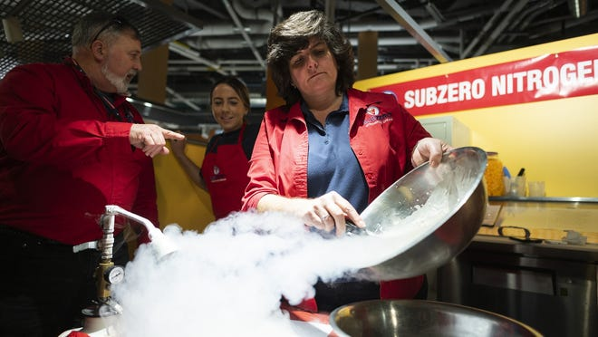 Rita McCabe, owner of Sub Zero Nitrogen Ice Cream, shows off a concoction during the grand opening of the Worcester Public Market in February.