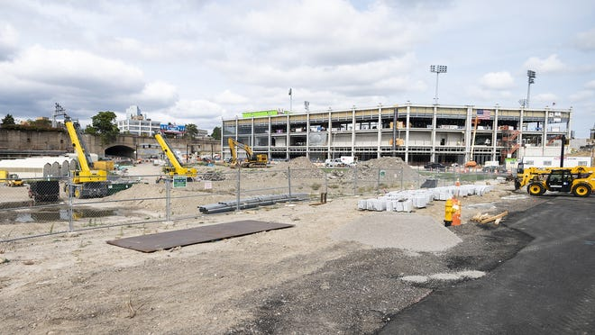 Work continues on the Polar Park ballfield Friday. The city has amended its agreement with the private developer of a redevelopment project that sits in the shadow of the stadium.