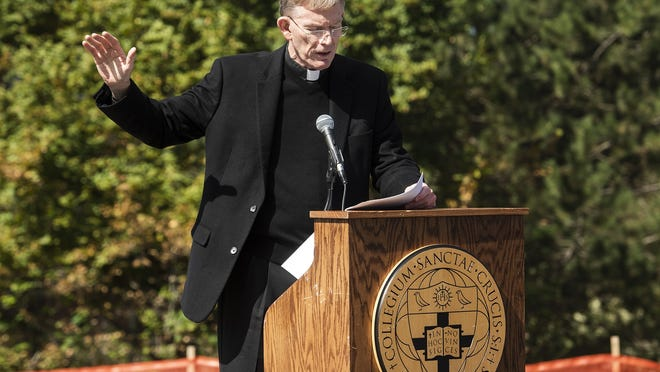 The Rev. Philip Boroughs blesses the building during the topping off ceremony for the new Joanne Chouinard-Luth Recreation and Wellness Center, a state-of-the-art facility for campus recreation and intramural sports at Holy Cross on Sept. 18, 2019.