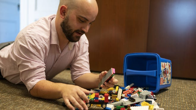Danny Quin, associate digital/social media specialist with UMass Memorial Health Care, wrote a blogpost for the hospital last year discussing the stigma of mental health. Now, he wants to start a podcast talking with people who have decided to use their platform to make an impact on those who may be struggling with mental illness. One of his coping mechanisms when dealing with anxiety is building Legos with his children.