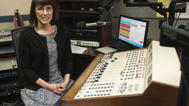 """Mary Frandsen, executive director of Audio Journal, is pictured in the studio in June. The pandemic has affected the """"Speaking Volumes"""" book club, she says.  """"No longer are volunteers meeting in the studio on the first Tuesday of the month to broadcast their discussion live. A day before the broadcast, they use Zoom to record their discussion. Unfortunately, listeners are not able to call in through Zoom."""""""