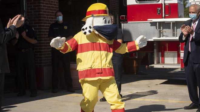 Sparky, the Worcester Fire Department's new mascot, is introduced to help kick off Fire Prevention Month outside Worcester Fire Headquarters on Thursday.