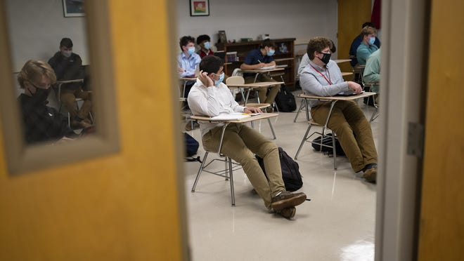 Students attend a class Friday at St. John's High School in Shrewsbury.