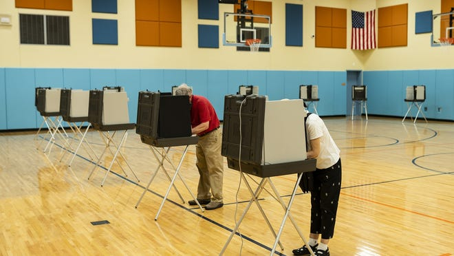 Voters mark their ballots during early voting at Nelson Place Elementary School in August, before the primary. The school will again be used for early voting, this time for the general election.