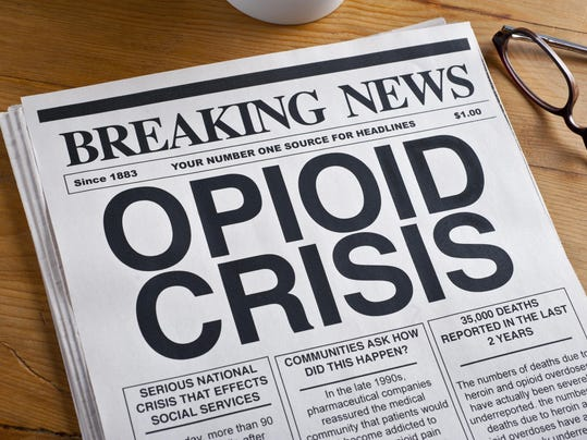 Opioid Crisis Newspaper Headline. Newspaper is on a Desk