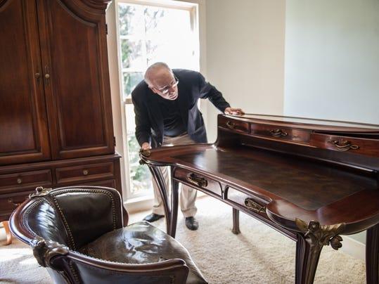 Longshot Goldberg inspecting desk.jpg