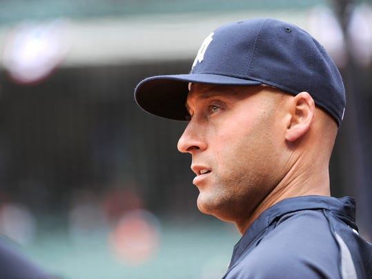 New York Yankees' Derek Jeter looks out to the field before a baseball game against the Houston Astros on opening day Tuesday, April 1, 2014, in Houston. (AP Photo/Pat Sullivan)