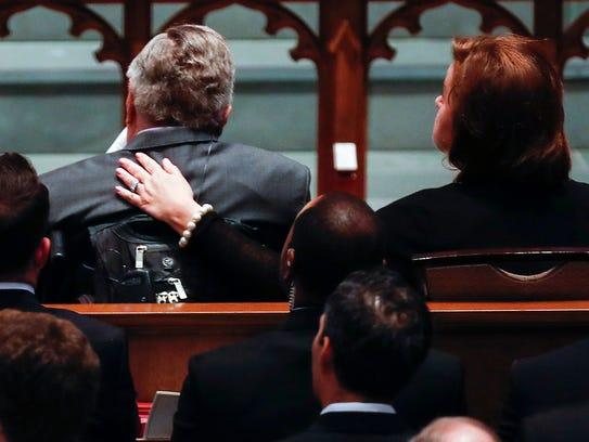 """Dorothy """"Doro"""" Bush Koch wraps her arm around her father,"""