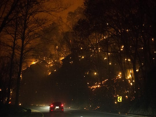 Fire erupts on both sides of Highway 441 near the Spur the evening of Nov. 28.