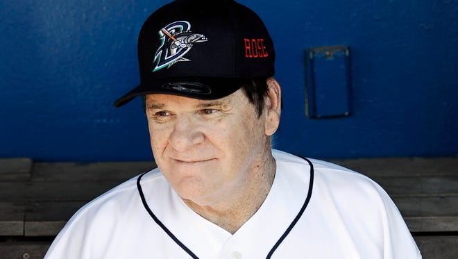 Pete Rose smiles while sitting in the dugout at The Ballpark at Harbor Yard, Monday, June 16, 2014, in Bridgeport, Conn. Rose, banned from Major League Baseball, returned to the dugout for one day to manage the independent minor-league Bridgeport Bluefish.
