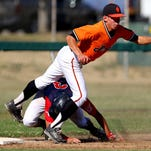 Dallas DeMarini Dirtbags third baseman Connor Mattison comes down on top of Medford Mustangs base runner Tate Cowden as he safely makes it to the base during the American Legion state tournament at Chemeketa Community College, Thursday, July 30, 2015, in Salem, Ore.
