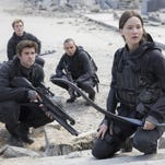 "Liam Hemsworth, left, as Gale Hawthorne, Sam Clafin, back left, as Finnick Odair, Evan Ross, back right, as Messalia, and Jennifer Lawrence, right, as Katniss Everdeen, star in the film, ""The Hunger Games: Mockingjay - Part 2."" The movie opens in U.S. theaters on Friday."