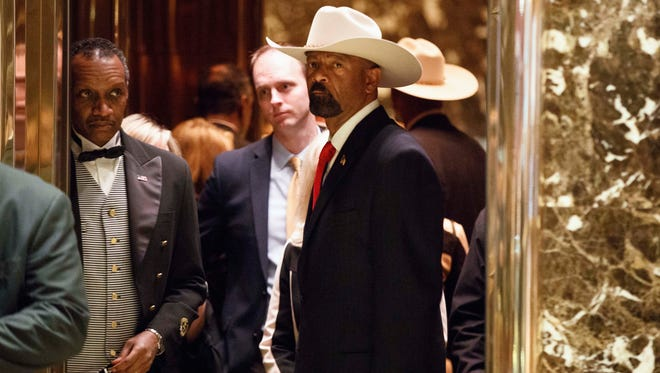 Milwaukee County Sheriff David Clarke gets on an elevator after arriving at Trump Tower in New York in November.