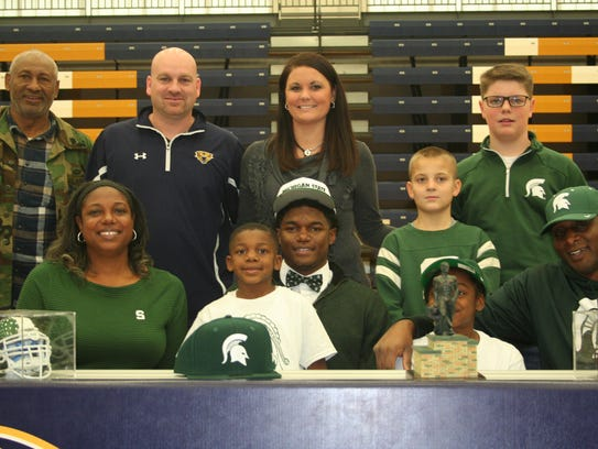 Battle Creek Central's Brandon Randle signs  his National