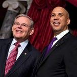 Sen. Cory Booker, right, standing with Sen. Bob Menendez. (AP photo)