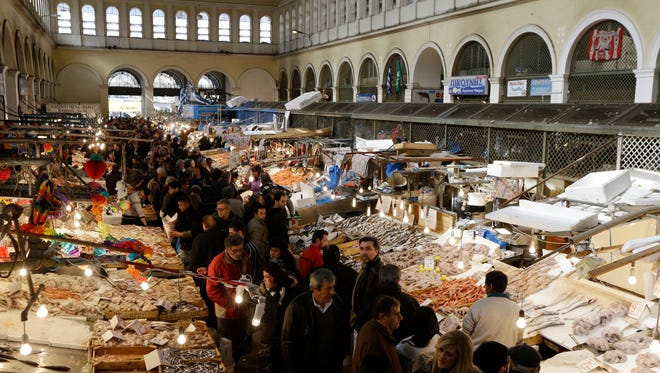 Shoppers fill the central fish market ahead of the Christian Orthodox lent fast, in Athens, on Friday.