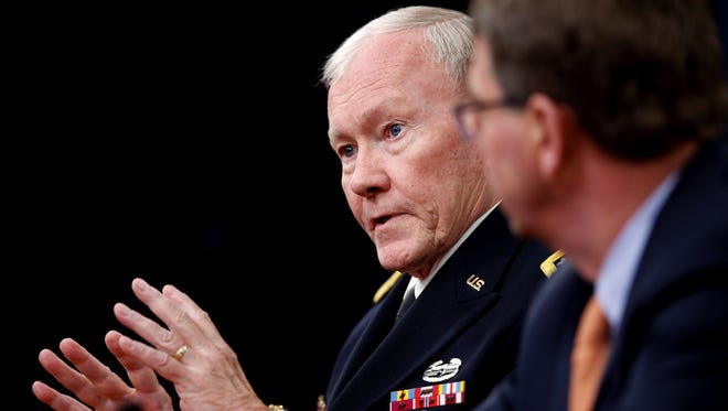 Defense Secretary Ash Carter, right, listens as Joint Chiefs Chairman Gen. Martin Dempsey, left, speaks during a news conference at the Pentagon on Thursday, April 16, 2015.