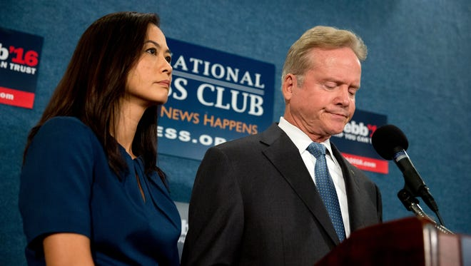 Former Virginia senator Jim Webb, accompanied by his wife, Hong Le Webb, announces he will drop out of the Democratic race for president on Oct. 20, 2015, in Washington.