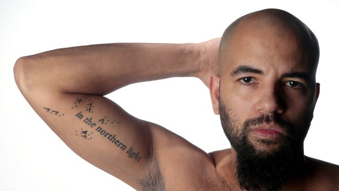 Marcus Roach is a participant in the Cincinnati Tattoo Project. His tattoo is a line from the poem written by Chase Public.