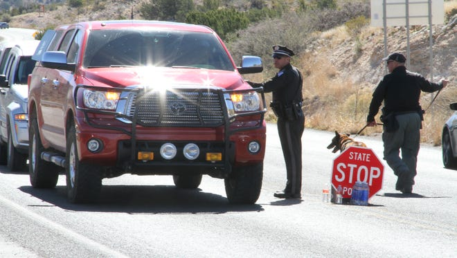 New Mexico State Police officers set up a checkpoint on U.S. Highway 82 near Dry Canyon Thursday after two violent convicts escaped from a prisoner transport van Wednesday evening.
