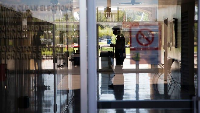 Adam Bevell, a blind entrepreneur, restocks vending machines at State Land Department Building in downtown Phoenix.