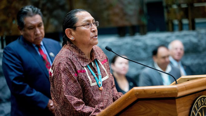Pueblo of Acoma Gov. Kurt Riley, center, accompanied by Pueblo of Acoma Traditional Leader Conroy Chino, left, speaks as a group of American Indian Nations and American Indian advocates hold a news conference at the Smithsonian National Museum of the American Indian, in Washington, Tuesday, May 24, 2016, to contest a Paris auction house's upcoming auction of Native American remains and sacred objects. The items are slated to be sold by the EVE auction house in Paris on May 30.