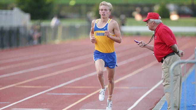 Carmel distance runner Ben Veatch led the pack in the 3200 meter race during the Boys Sectional Track and Field Meet on May 19 at Carmel High School.
