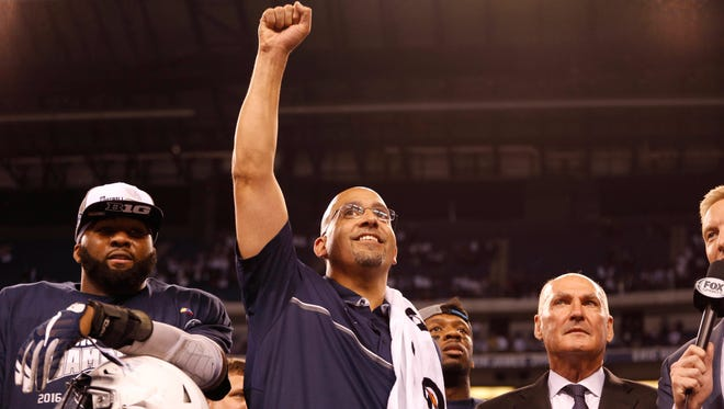 Penn State coach James Franklin celebrates after defeating the Wisconsin in the Big Ten championship college game.