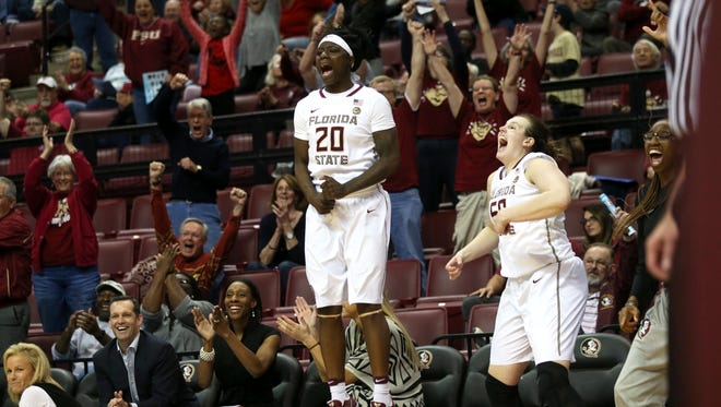 FSU's Shakayla Thomas, center, and Chatrice White cheer on their teammates as they defeat Wake Forest 102-60 at the Tucker Civic Center on Thursday, Feb. 9, 2017.