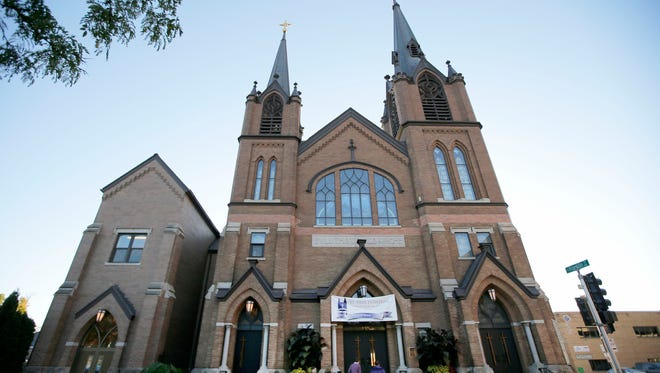 Members of the congregation arrive at St. Paul Lutheran Church Sunday in Appleton. The church celebrates its 150th anniversary this year.