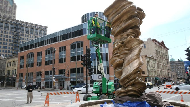 """Tony Cragg's """"Mixed Feelings,"""" part of last year's Sculpture Milwaukee, has been gifted to the City of Milwaukee by an anonymous donor and was installed Monday in front of City Hall."""