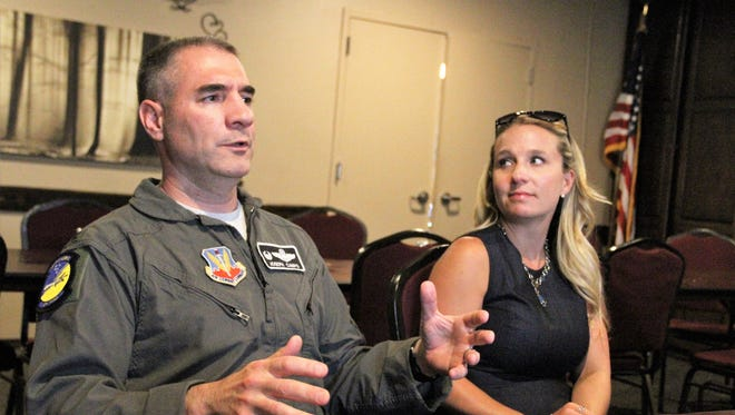 Holloman Commander Col. Joseph Campos talks about Holloman's mission while his wife Sarah looks on.