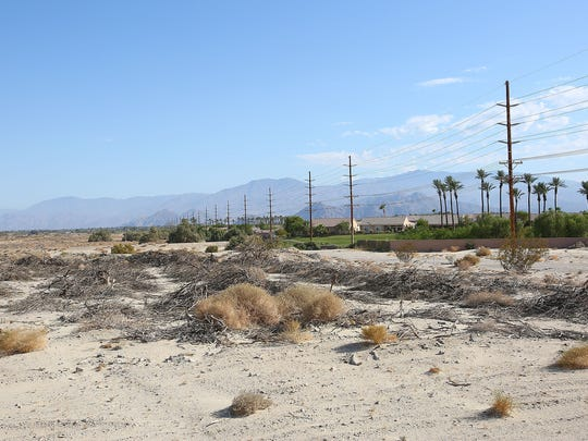 The site of new master planned community adjacent to Sun City Palm Desert, at right, where 1,300 homes will be built on 660 acres in north Indio, June 27, 2016.