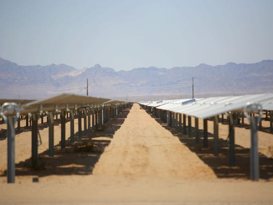 Solar panels soak up the sun at the 250-megawatt McCoy solar project on federal land near Blythe, California on June 22, 2016.