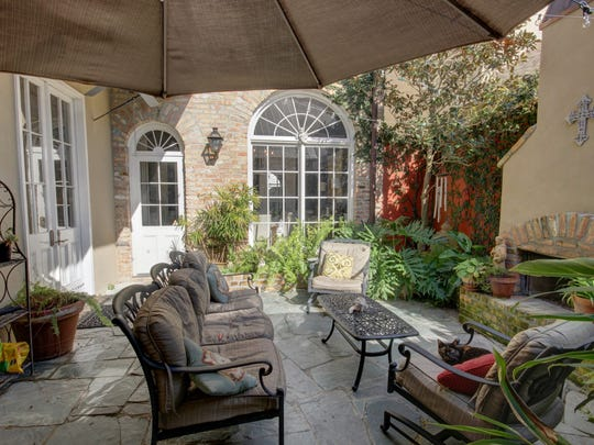 The outdoor living space is modeled after a New Orleans courtyard.