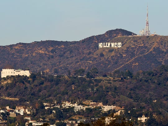"""The Hollywood sign is seen vandalized Sunday, Jan. 1, 2017. Los Angeles residents awoke New Year's Day to find a prankster had altered the famed Hollywood sign to read """"HOLLYWeeD."""" Police have notified the city's Department of General Services, whose officers patrol Griffith Park and the area of the rugged Hollywood Hills near the sign. California voters in November approved Proposition 64, which legalized the recreational use of marijuana, beginning in 2018."""