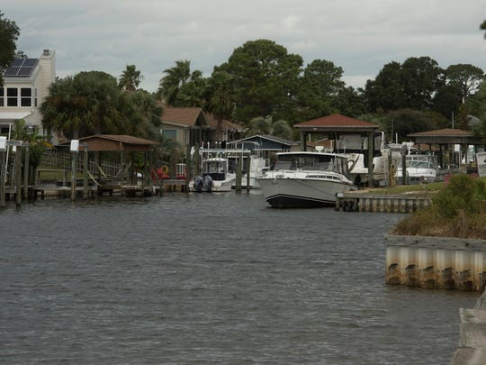 Santa Rosa Shore residents are seeking a permit to dredge the three channels connecting the neighborhood to the intercoastal waterway and to save seagrasses in the area.