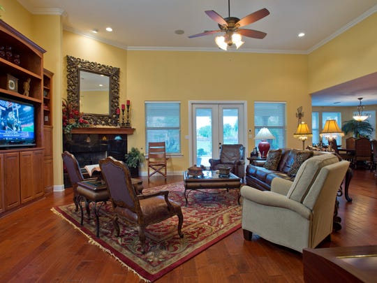 The spacious living space features high ceilings, corner