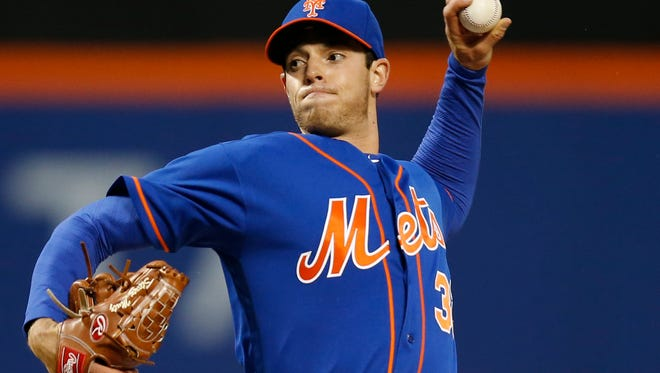 New York Mets starting pitcher Steven Matz (32) delivers in the first inning of a baseball game against the Miami Marlins, Monday, April 11, 2016, in New York. (AP Photo/Kathy Willens)