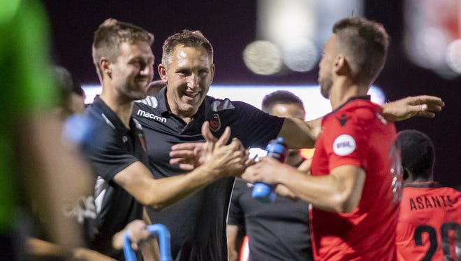Interim head coach Rick Schantz of Phoenix Rising FC celebrates a goal against Las Vegas Lights FC at Phoenix Rising FC Soccer Complex on Wednesday, June 13, 2018 in Tempe, Arizona.