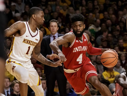Hoosiers guard Robert Johnson (4) dribbles in the first